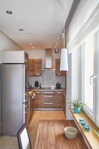 Küche/Küchenzeile in der Unterkunft Stadion Narodowy 2-Bedroom Apartment