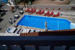 A view of the pool at Vasilaras Hotel or nearby