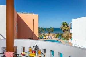 A balcony or terrace at Eden Beach Hotel
