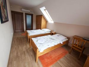 A bed or beds in a room at Apartment Pavlinka