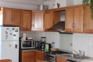 A kitchen or kitchenette at Casa da Aguada