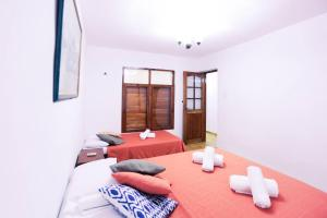 A bed or beds in a room at Apt. Mercaderes 259