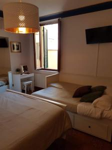 A bed or beds in a room at City Hub 1 Apartment