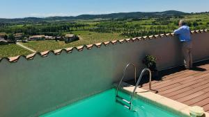A view of the pool at Le Fort Pouzols-Minervois or nearby