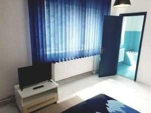 A television and/or entertainment center at Old Town Central Apartment