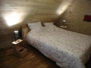 Un ou plusieurs lits dans un hébergement de l'établissement House L'oustal de georges