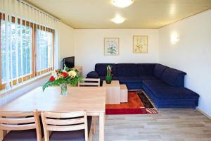 A seating area at Holiday resort Erzeberg Bad Emstal - DMG011005-FYA
