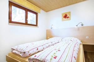 A bed or beds in a room at Holiday resort Erzeberg Bad Emstal - DMG011005-FYB