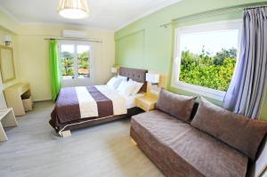 Ένα ή περισσότερα κρεβάτια σε δωμάτιο στο Vliho Bay Suites & Apartments