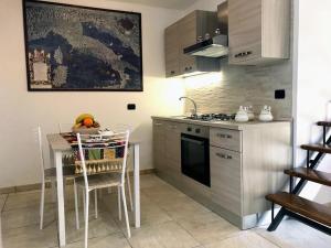 Kuchyň nebo kuchyňský kout v ubytování Antica Corte Appartament