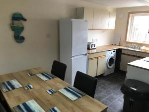 A kitchen or kitchenette at Self Catering Accommodation, Isle of Benbecula