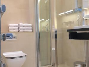 A bathroom at Trafalgar Luxury Suites