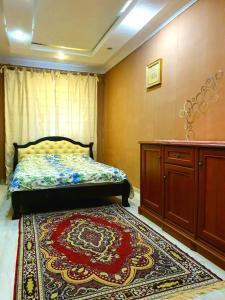 Кровать или кровати в номере Apartment Ushakova 16