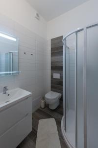 Koupelna v ubytování Apartmány Resident