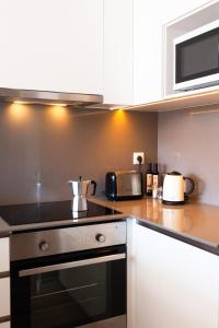 A kitchen or kitchenette at Brummell Apartments Poble Sec