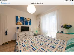 Ένα ή περισσότερα κρεβάτια σε δωμάτιο στο Taormina Stationhouse