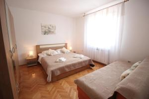 A bed or beds in a room at Casa Lidija