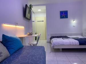 A bed or beds in a room at Bačvice beach apartment