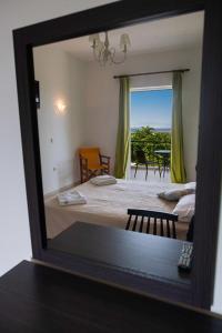A bed or beds in a room at Bella Casa Studios