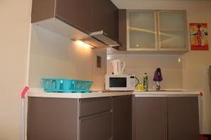 A kitchen or kitchenette at Amazing Suites at Regalia KLCC