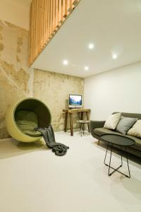 A seating area at city center designer apartment in Eclectic building