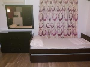 Ένα ή περισσότερα κρεβάτια σε δωμάτιο στο Manos Apartments