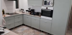 A kitchen or kitchenette at Chez Anny