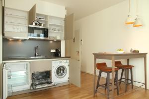 A kitchen or kitchenette at HighPark by Palmira