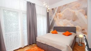 Tempat tidur dalam kamar di Astra 8
