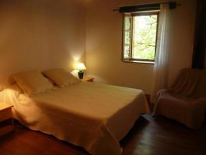 Un ou plusieurs lits dans un hébergement de l'établissement House Gite la mezzanine