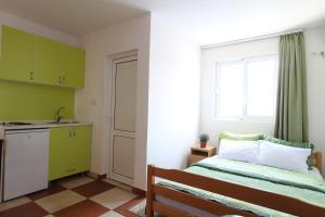 A bed or beds in a room at Apartment Dasic
