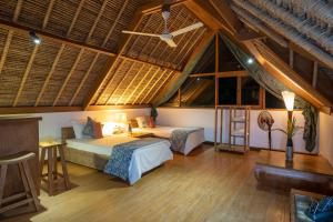 A bed or beds in a room at Villa Nusa