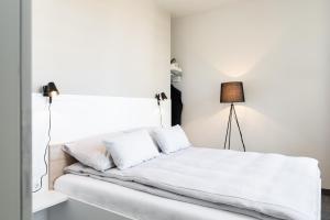 Ein Bett oder Betten in einem Zimmer der Unterkunft HUB-Apartments