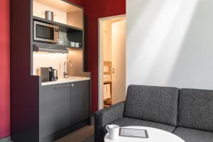 Ein Sitzbereich in der Unterkunft HUB-Apartments