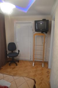 A television and/or entertainment center at Apartment Kutaisi L&l