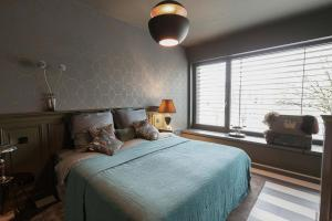 A bed or beds in a room at NOMADS by Suite.030 high class apartments, 1-3 bedrooms