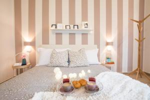A bed or beds in a room at La Dotta apartments
