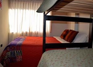 A bunk bed or bunk beds in a room at Casa G & F Aparthotel