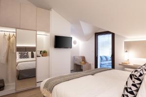 Säng eller sängar i ett rum på Hotel Rezi