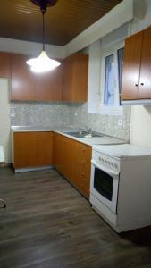 A kitchen or kitchenette at Οικία κοντά στη θάλασσα
