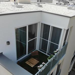 A balcony or terrace at VIC & UNO City Charming Apart Plus Garage