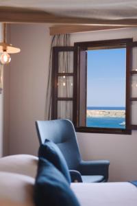 Χώρος καθιστικού στο Thea Villas and Suite