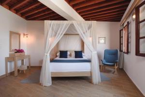 Ένα ή περισσότερα κρεβάτια σε δωμάτιο στο Thea Villas and Suite