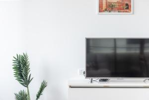 A television and/or entertainment center at Southern Cross Station Apt