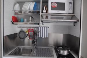 A kitchen or kitchenette at Time Out ApartHotel