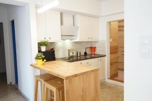 A kitchen or kitchenette at beach apartments