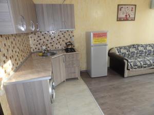 Кухня или мини-кухня в ApartHotel My Home