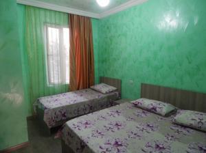 Кровать или кровати в номере ApartHotel My Home