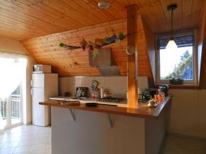 Küche/Küchenzeile in der Unterkunft Gite un P'tit Coing de Campagne