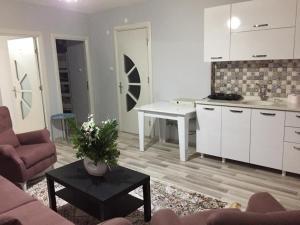 A kitchen or kitchenette at Park Rezidans